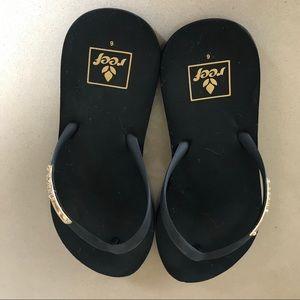 Reef Black Flip Flops with Gold Embellishment